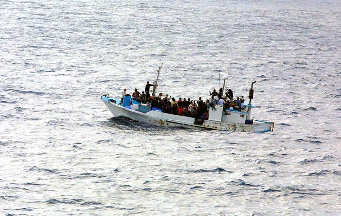 Refugees_on_a_boat-sized