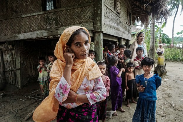 A Rohingya family stands outside their home in Maung Hnama village, Buthidaung township, western Myanmar's Rakhine state, July 13, 2017. Courtesy to Benar News